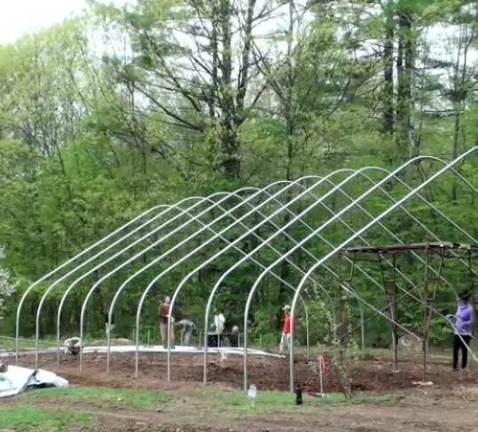Raising The Hoop House In 90 Seconds